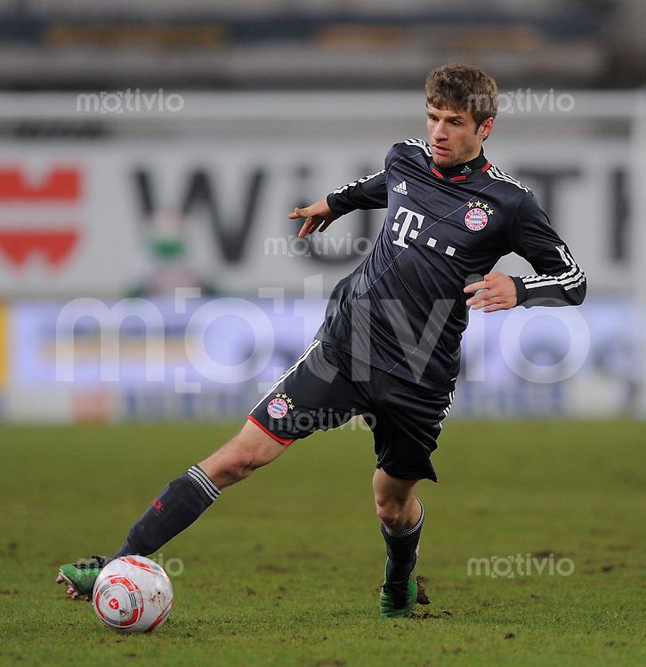 FUSSBALL   1. BUNDESLIGA   SAISON 2010/2011  17. SPIELTAG    19.12.2010 VfB Stuttgart - FC Bayern Muenchen Thomas Mueller (FC Bayern Muenchen) am Ball