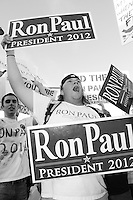Mesa, Arizona. February 23, 2012 - As Republican candidates debated in the Mesa Arts Center, protesters including undocumented students, tea partiers, occupy movement members and Syrian president opponents, shouted slogans and held up signs and placards outside. In this photograph, supporters of U.S. Republican presidential candidate Ron Paul demonstrate outside the complex where Paul debated with Mitt Romney, Rick Santorum, and Newt Gingrich. Photo by Eduardo Barraza © 2012