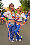 Garden City, New York, U.S. - June 6, 2014 -  L-R, ASHLEEN and JENNA, New York Islanders Ice Girls, pose at the Garden City Belmont Stakes Festival, celebrating the 146th running of Belmont Stakes at nearby Elmont the next day. There was street festival family fun with live bands, food, pony rides and more, and a main sponsor of this Long Island night event was The New York Racing Association Inc.