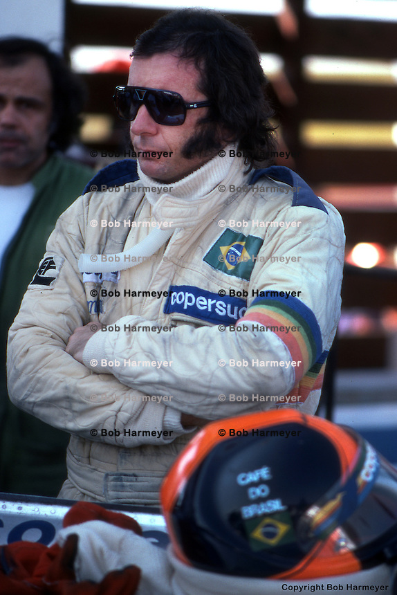 BOWMANVILLE, ONT - OCTOBER 3: Emerson Fittipaldi waits to drive his Fittipaldi FD04 4/Ford Cosworth during practice for the Canadian Grand Prix on October 3, 1976, at Mosport Park near Bowmanville, Ontario.