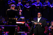 Eric Owens, bass-baritone, right, performs Johannes Brahms' &quot;Requiem&quot; with the United States Navy Sea Chanters, the Marine Chamber Orchestra, and the Washington National Cathedral Choir at &quot;The Washington National Cathedral's A Call to Compassion&quot; being hosted at the John F. Kennedy Center for the Performing Arts in Washington, D.C. on Friday, September 9, 2011 to commemorate the tenth anniversary of 9/11 .Credit: Ron Sachs / Pool via CNP