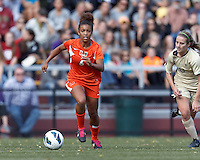 University of Miami midfielder Jordan Roseboro (6) dribbles at midfield. .After two overtime periods, Boston College (gold) tied University of Miami (orange), 0-0, at Newton Campus Field, October 21, 2012.