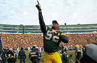 """Green Bay Packers defensive end Reggie White, known as """"The Minister of Defense"""", points Heavenward as the Packers win the NFC Championship against the Carolina Panthers 30-13 on January 12, 1997 and thus return to the Super Bowl for the first time in 29 years. This was the first title game in Green Bay since the """"Ice Bowl"""" in 1967."""