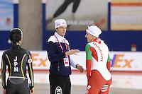 SCHAATSEN: CALGARY: Olympic Oval, 09-11-2013, Essent ISU World Cup, Jan Bos (trainer/coach KIA Speed Skating Academy),  Ágota Toth-Lykovcan (HUN), ©foto Martin de Jong