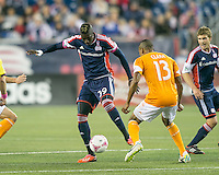 New England Revolution midfielder Saer Sene (39) controls the ball near the Houston goal as Houston Dynamo midfielder Ricardo Clark (13) prepares to defend.  The New England Revolution played to a 1-1 draw against the Houston Dynamo during a Major League Soccer (MLS) match at Gillette Stadium in Foxborough, MA on September 28, 2013.