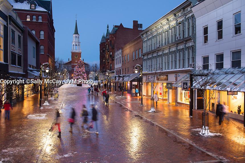 Church Street, Burlington, Vermont at twilight on a winter day. Burlington, Vermont and Lake Champlain