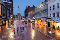 Church Street, Burlington, Vermont at twilight on a winter day. Burlington, Vermont and Lake Champlain