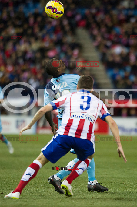 Atletico de Madrid&acute;s Guilherme Siqueira and Rayo Vallecano&acute;s Gael Kakuta during 2014-15 La Liga match between Atletico de Madrid and Rayo Vallecano at Vicente Calderon stadium in Madrid, Spain. January 24, 2015. (ALTERPHOTOS/Luis Fernandez) /NortePhoto<br />