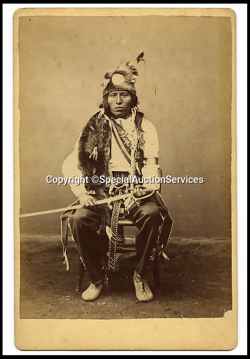 BNPS.co.uk (01202 558833)<br /> Pic: SpecialAuctionServices/BNPS<br /> <br /> *Please use full byline*<br /> <br /> Lot 406-2.  Little Soldier, Cree Tribe.<br /> <br /> Poignant insight into a lost world...<br /> <br /> An important collection of Native American Images - including a portrait of the famous Sitting Bull - will be offered in the Photographica sale on Thursday 23rd October and is expected to fetch over &pound;10,000.<br /> <br /> The photographs were collected by the vendor&rsquo;s great grandfather during his travels to America. He first journeyed to North America in 1862 to find out more about Native Indians and subsequently returned in 1866, 1874 and several times after that. The first three trips are described in a book that he wrote and published in 1890 entitled Sport and Adventures amongst the North American Indians.<br /> <br /> The collection comprises 127 images taken by pioneering photographers including American government photographer John Karl Hillers (1843- 1925) and explorer and painter William. H. Jackson. It contains portraits as well as scenes of family and working life that provide a real insight into everyday living in the 1870s &ndash; 1880s. Estimates for the group lots range from &pound;100 to &pound;5,000.<br /> <br /> The photographs were taken using the latest technology of the time; the invention of dry-plate made it possible for photographers to go into the wilds of native USA and document everyday life; and the use of traditional stereoscopic photography means the subjects in the portrait shots appear 3-Dimensional. <br /> <br /> Hugo Marsh, Head of Photographica says: &ldquo;This collection of photographs provides us with a greater understanding and a terrific insight into the lives of Native American Indians of the time. It is rare to see a large collection in such good condition.&rdquo;