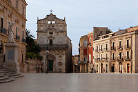 Low angle view of the front of Chiesa Santa Lucia alla Badia seen in a early morning light in Ortigia, Syracuse, Sicily, pictured on September 14, 2009, in the morning. The baroque Church of Santa Lucia alla Badia, built on the Piazza del Duomo after the 1693 earthquake, houses the Burial of St. Lucia by Michelangelo da Caravaggio. The island Ortigia is the historic centre of Syracuse. Today the city is a UNESCO World Heritage Site. Picture by Manuel Cohen.