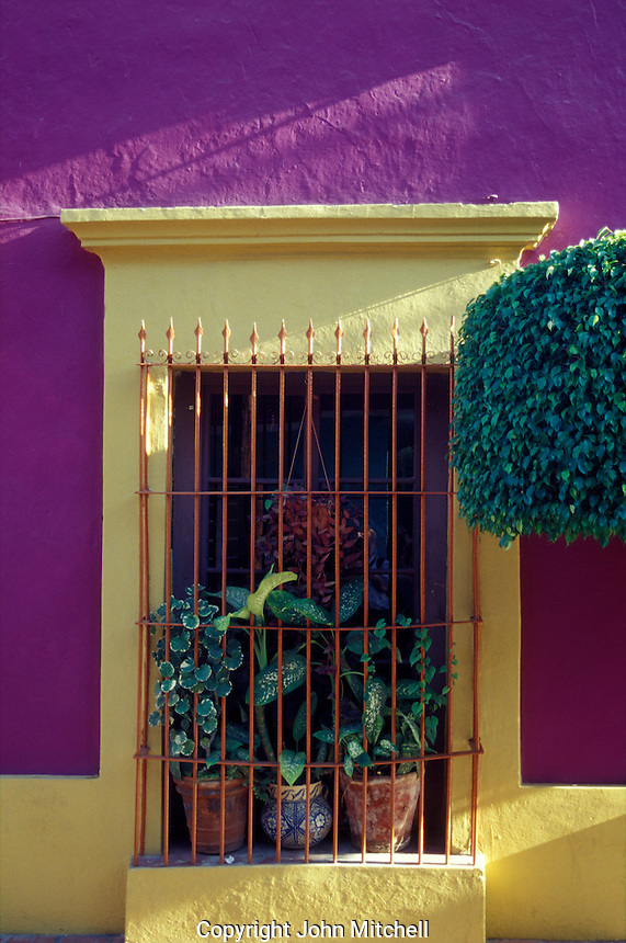 Barred window of a restored Spanish colonial house in old Mazatlan, Sinaloa, Mexico