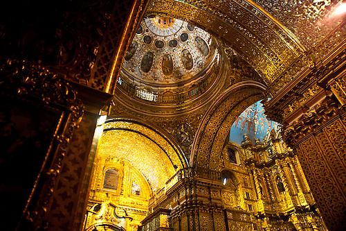 The golden interior of a church in Quito, Ecuador.