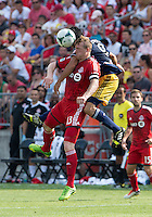 20 July 2013: Toronto FC defender Steven Caldwell #13 and New York Red Bulls forward Fabian Espindola #9 in action during an MLS regular season game between the New York Red Bulls and Toronto FC at BMO Field in Toronto, Ontario Canada.<br /> The game ended in a 0-0 draw.