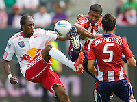 Chivas USA defender Michael Umana (4) battles with NY RedBulls forward Macoumba Kandji (10). Chivas USA defeated the Red Bulls of New York 2-0 at Home Depot Center stadium in Carson, California April 10, 2010.  .