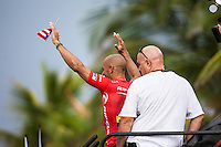 SOMEWHERE, Porta Del Sol/Puerto Rico (Saturday, November 6, 2010) &ndash;Kelly Slater (USA) with David 'Woody&quot; Wood (AUS) head of security fro the ASP. Slater, 38, made sporting history today, claiming an unprecedented 10th ASP World Title at Rip Curl Pro Search Puerto Rico.<br />  <br /> With his advancement out of the Quarterfinals of the Rip Curl Pro Search Puerto Rico over Adriano de Souza (BRA), 23, Slater amassed enough points to move out of reach remaining contender Jordy Smith (ZAF), 22, and collect the 2010 ASP World Title, culminating a 20-year effort.<br /> Kelly Slater (USA), 38, newly-crowned 10-time ASP World Champion, has claimed his 45th elite tour event, taking down the Rip Curl Pro Search Puerto Rico over Bede Durbidge (AUS), 27, in pumping three-to-four foot (1.5 metre) waves in Porta Del Sol.<br />  <br /> Event No. 9 of 10 on the 2010 ASP World Tour, the Rip Curl Pro Search Puerto Rico has been an event of extremes.<br />  <br /> Last Tuesday, the international sporting world was dealt a devastating blow with the tragic and unexpected loss of former three-time ASP World Champion and current ASP World Tour competitor Andy Irons (HAW), 32.<br />  <br /> After a somber two-day postponement of the event out of respect for Irons&rsquo;s passing, the world&rsquo;s best surfers roared back to life for two of the most high-performance days in surfing history.<br />  <br /> Today, Slater clinched his historic and unprecedented 10th ASP World Title before going on to take out the Rip Curl Pro Search Puerto Rico, as comprehensive and dominant a performance as the sporting world has ever bore witness to.<br /> Photo: joliphotos.com