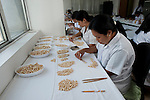 Sorting of Jewelmer pearls in Manila