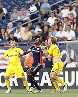 New England Revolution forward Dimitry Imbongo (92) and Columbus Crew forward Eddie Gaven (12) battle for the ball. In a Major League Soccer (MLS) match, the New England Revolution defeated Columbus Crew, 2-0, at Gillette Stadium on September 5, 2012.