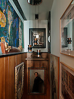 Above the stairs hangs a Verner Panton chandelier. To the left on the wall is a Senol Yorozlu painting, and the portrait of a woman is by Frederique Vallet Bisson