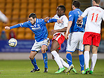St Johnstone v Ross County...15.03.14    SPFL<br /> Tim Clancy holds off Jordan Slew<br /> Picture by Graeme Hart.<br /> Copyright Perthshire Picture Agency<br /> Tel: 01738 623350  Mobile: 07990 594431