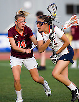 Caroline McTiernan (22) of Virginia tries to find a way past Julie Wolfinger (14) of Virginia Tech during the first round of the ACC Women's Lacrosse Championship in College Park, MD.  Virginia defeated Virginia Tech, 18-6.