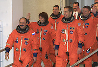 Space Shuttle Discovery crew members Yury Usachev, Susan Helms, James Weatherbee, James, Kelley, Andrerw Thomas and Paul Richards wave tot he media as they walk to the van which will transport them to the launch pad for the STS 102 Mission, Kennedy Space Center, Titiusville, FL,  March 2001.  (Photo by Brian Cleary/www.bcpix.com)