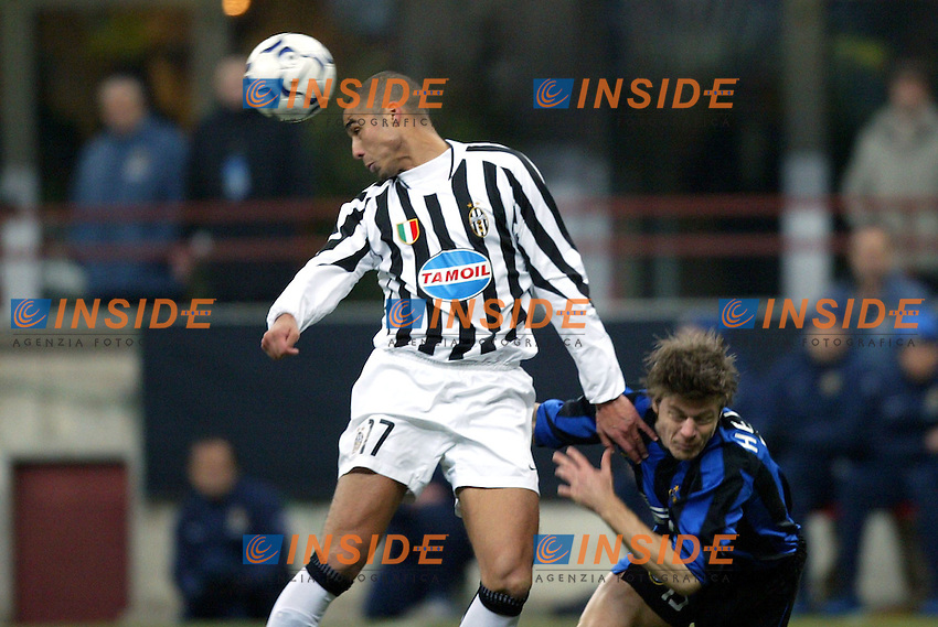 Milano 12/2/2004 Coppa Italia - Italy Cup - Semifinale <br /> Inter - Juventus 2-2 (6-7 after penalties) <br /> David Trezeguet (Juventus) challenged by Thomas Helveg (Inter)<br /> Photo Insidefoto