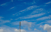 Transmitting aerial set against high cirrus clouds.