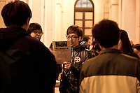"In the corridor of the LEGCO, young hongkongers are singing  ""Power to the People !"" calling for democracy now, in Hong-kong during the rally organized after the resignation of five Lawmakers of the Civic Party and the Social Democrats League,evening of 01/27/2010, Chater Garden."