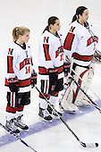 Casey Pickett (NU - 14), Claire Santostefano (NU - 13), Leah Sulyma (NU - 1) - The Harvard University Crimson defeated the Northeastern University Huskies 4-3 (SO) in the opening round of the Beanpot on Tuesday, February 8, 2011, at Conte Forum in Chestnut Hill, Massachusetts.