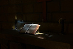 A bible sits in front of a 15 c. stained glass window at Frontier Nursing University in Hyden, Ky., on Wednesday, October 9, 2013. Photo by Eleanor Hasken