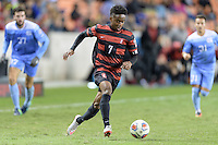 Houston, TX - Friday December 9, 2016: Bryce Marion (7) of the Stanford Cardinal brings the ball up the field against the North Carolina Tar Heels at the NCAA Men's Soccer Semifinals at BBVA Compass Stadium in Houston Texas.