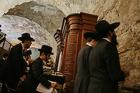 Followers of Shas spiritual leader Rabbi Ovadia Yosef pray for Rabbi Yosef's medical recovery at the Western Wall, Judaism's holiest site in the Old City of Jerusalem, September 23, 2013, Rabbi Ovadia Yosef, who is hospitalized in Hadassah Ein Kerem Hospital in Jerusalem, has been put on a respirator, and doctors are draining fluid from his lungs and are considering putting him under full anesthesia due to his deteriorating health. Photo by Oren Nahshon