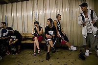 The Far East Ballers, a Japanese street basketball team, ride back to their hotel on the subway from a game in the Dyckman Tournament, New York City, USA, June 17 2005.
