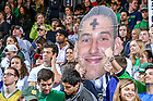 March 1, 2017; The Leprechaun Legion student section at a Men's Basketball game holds a 'fathead' with ashes in recognition of the game being played on Ash Wednesday. (Photo by Matt Cashore)