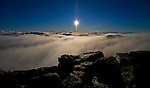 Clouds at sunrise atop 10,023 foot Haleakala Volcano Crater in the middle of the Pacific Ocean in Haleakala National Park on the Island of Maui, Hawaii. - Photo by Jim Urquhart/Straylighteffect.com<br />