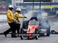 May 17, 2014; Commerce, GA, USA; Safety Safari members assist NHRA top fuel dragster driver Chris Karamesines during qualifying for the Southern Nationals at Atlanta Dragway. Mandatory Credit: Mark J. Rebilas-USA TODAY Sports