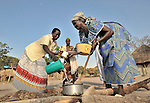Women cooking in the Southern Sudan village of Yondoru. Families here are rebuilding their lives after returning from refuge in Uganda in 2006 following the 2005 Comprehensive Peace Agreement between the north and south.