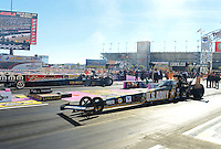 Oct. 27, 2012; Las Vegas, NV, USA: NHRA top fuel dragster driver Tony Schumacher (near) races alongside Troy Buff during qualifying for the Big O Tires Nationals at The Strip in Las Vegas. Mandatory Credit: Mark J. Rebilas-