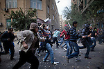 Protesters advanced against the police on Mohamed Mahmoud Street near Tahrir Square, Cairo, Egypt, Sunday, Nov. 20, 2011. Around 1500 people have been injured and 23 killed in the clashes ahead of Egypt's parliamentary election beginning on November 28.