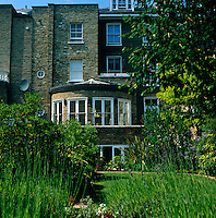 View of the rear facade of a typical Victorian house seen from the garden