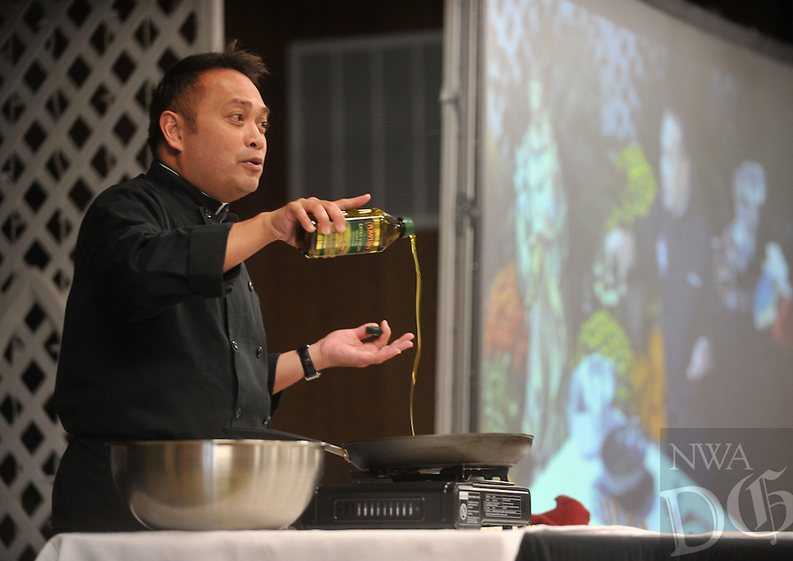 NWA Democrat-Gazette/MICHAEL WOODS &bull; @NWAMICHAELW<br /> Father Leo Patalinghug, Host of Grace Before Meals, leads a cooking demonstration with a  &ldquo;Spice up your marriage&rdquo; message Saturday October 17, 2015 at St. Joseph Catholic Church in Tontitown.  Patalinghug is the Founder, Host, and Director of Grace Before Meals, an international apostolate to help strengthen families and relationship through God's gift of a family meal.