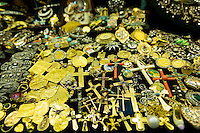 Gold jewelry religious icons and cross in The Grand Bazaar, Kapalicarsi, great market in Beyazi, Istanbul, Turkey