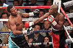 May 1, 2010; Las Vegas, NV; USA; Floyd Mayweather (orange/black) defeats Shane Mosley (black/blue) via 12 round unanimous decision at the MGM Grand Garden Arena in Las Vegas, NV.