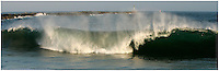 20 June 2006:  Single set wave rolls a shore during a South swell reaches the famous surf spot in Newport Beach, CA called The Wedge.  Surfers, boogie boarders, body surfers and crowds gather to watch the powerful waves and the waters take shape into unique sets along the jetty in Orange County, California.