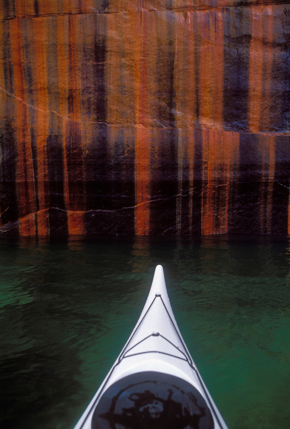 Sea kayak bow with the namesake mineral stains of pictured rocks