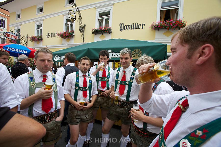 "Kärntnernudelfest (Carinthian Dumplings Festival) in Oberdrauburg 2011. Shoe plattlers ""Hochstadlbuam"" having a beer after dancing."