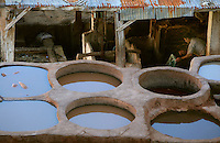 Detail of Chouara Tannery, Fez, Morocco, pictured on February 23, 2009 in the evening sunshine whose low rays are lighting a cramped shed equipped with a washing wheel for the raw skins. The Chouara tannery is the largest of the four ancient tanneries in the Medina of Fez where the traditional work of the tanners has remained unchanged since the 14th century. It is composed of numerous dried-earth pits where raw skins are treated, pounded, scraped and dyed. Tanners work in vats filled with various coloured liquid dyes derived from plant sources. Colours change every two weeks, poppy flower for red, mint for green, indigo for blue, chedar tree for brown and saffron for yellow. Fez, Morocco's second largest city, and one of the four imperial cities, was founded in 789 by Idris I on the banks of the River Fez. The oldest university in the world is here and the city is still the Moroccan cultural and spiritual centre. Fez has three sectors: the oldest part, the walled city of Fes-el-Bali, houses Morocco's largest medina and is a UNESCO World Heritage Site;  Fes-el-Jedid was founded in 1244 as a new capital by the Merenid dynasty, and contains the Mellah, or Jewish quarter; Ville Nouvelle was built by the French who took over most of Morocco in 1912 and transferred the capital to Rabat. Picture by Manuel Cohen.