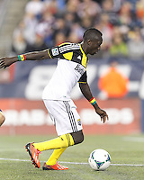 Columbus Crew forward Dominic Oduro (11) on the attack.  In a Major League Soccer (MLS) match, the New England Revolution (blue) defeated Columbus Crew (white), 3-2, at Gillette Stadium on October 19, 2013.