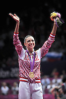August 11, 2012; London, Great Britain;  EVGENIYA KANAEVA of Russia celebrates gold in individual All-Around during medals ceremony at London 2012 Olympics.