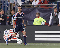 New England Revolution midfielder Diego Fagundez (14) looks to pass. In a Major League Soccer (MLS) match, the New England Revolution (blue) tied New York Red Bulls (white), 1-1, at Gillette Stadium on May 11, 2013.